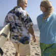 Couple at beach with surfboards — Stock Photo