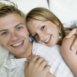 Couple Cuddling in Bed — Stock Photo