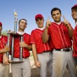 Baseball team with trophy on field — Stock Photo #33808099