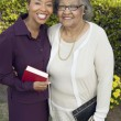 Daughter and Mother with Bibles — Stockfoto