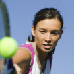 Female Tennis Player Hitting Ball — Stock Photo #33808407