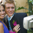 Stock Photo: Prom Couple Taking Photo
