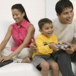 Father playing video game with son — Stock Photo #33808569