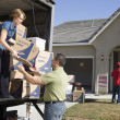 Couple unloading moving boxes — Stock Photo #33808571
