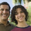 Father with Arm Around Son — Stock Photo #33808669