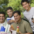Boy with father and brothers at picnic. — ストック写真