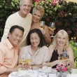 Friends toasting at dining table — Stock Photo