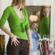 Woman Looking at Clothing — Foto Stock