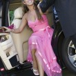 Stock Photo: Girl in dress being helped out of limo