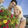 Couple Holding Hanging Plant — Stock Photo