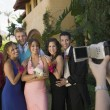 Stock Photo: Friends Being Videotaped at Prom