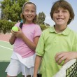 Brother and Sister at Tennis Net — Stock Photo