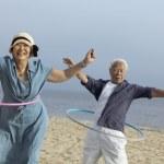 Couple with hula hoops — Stock Photo #33809211