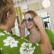 Man putting sunglasses on girlfriend — Stockfoto
