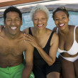 Senior woman with couple at swimming pool — Stock Photo