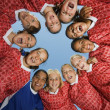 Smiling Girls Soccer Team in Huddle — Stock Photo #33809421