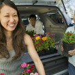 Family loading flowers — Stock Photo #33809487