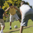 Men playing soccer — Stock Photo