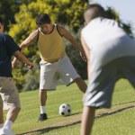 Men playing soccer — Stock Photo #33809525