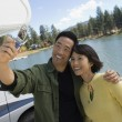 Couple taking picture of selves — Stock Photo