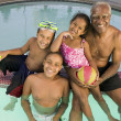 Stock Photo: Grandfather with Grandchildren in Pool