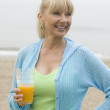 Stock Photo: Womon beach with juice