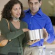 Couple Looking at Kitchenware — Stock Photo #33809639