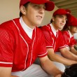 Baseball team-mates sitting in dugout — Stock Photo