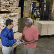 Men stock-taking in warehouse — Stock Photo #33809653
