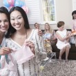 Woman with friend showing off gift — Stock Photo #33809689