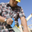 Construction worker sawing — Stock Photo #33809741