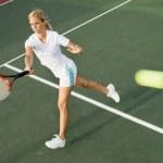 Tennis Player hitting tennis ball — Stock Photo #33809789