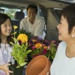 Family loading flowers — Stock Photo #33809925
