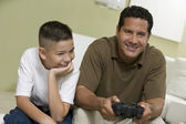 Son with father Playing Video Game — Stock Photo