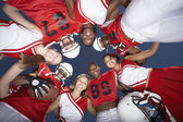 Football Players in Huddle — Stock Photo