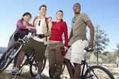 Friends with mountain bikes — Stock Photo