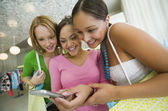 Girls Looking at Cell Phone picture — Stock Photo
