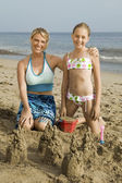 Mother and Daughter Building Sand Castle — Stock Photo