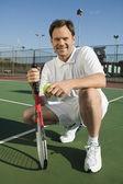 Man crouching on Tennis Court — Stock Photo