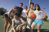 Group of young adults at basketball court. — Foto de Stock