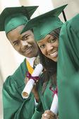 Graduates Holding Diplomas — Stock Photo