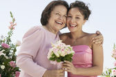 Mother and Bride with bouquet — Stock Photo