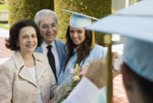 Graduate and grandparents — Stock Photo