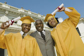 Graduates with father — Stock Photo