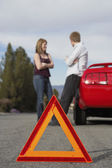 Motorists standing by broken down car — Stock Photo