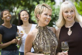 Women holding wineglasses — Stock Photo