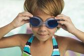 Girl adjusting goggles — Stock Photo