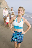 Woman on beach with family — Stock Photo