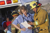 Fire fighters and paramedics — Stock Photo