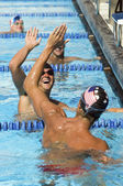 Swimmers High-Fiving — Stockfoto